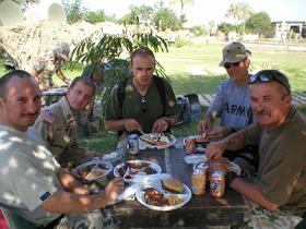 Unit picnic at Camp Babylon with the newly arrived Polish troops on July 27, 2003.