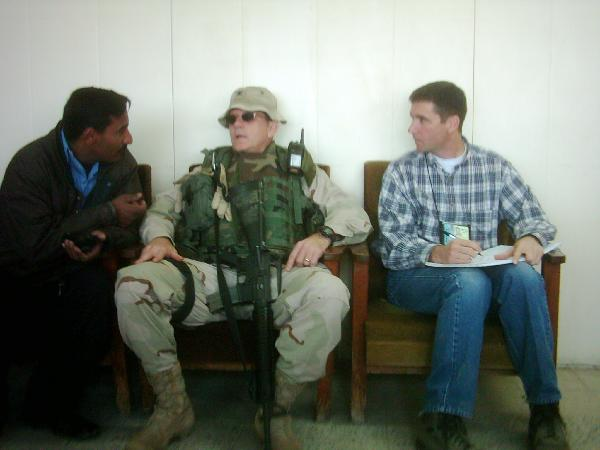 January 2004. I am translating the Spanish spoken by the Iraqi policeman to my right into English for Bob Zangas, seated to my left. Bob was killed in Iraq in March 2004.