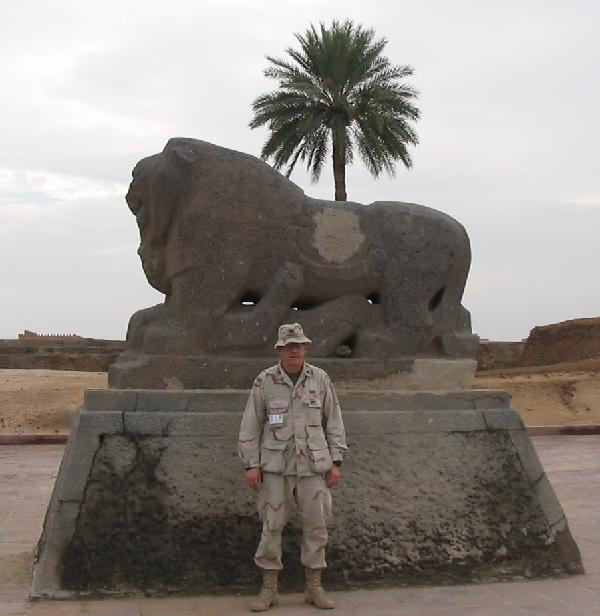 Colonel Michael WHitehead standing before the statue of The Lion of Babylon in August 2003.